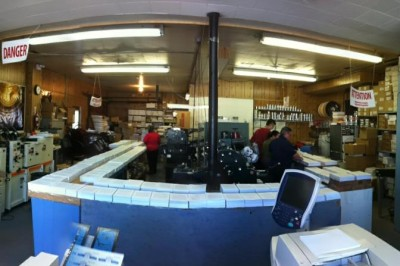 This is an image of a wide view of Charles Printing Shop with four staff at work.