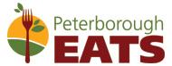 Le logo de Peterborough EATS se compose des images d'une fourchette et de feuilles sur deux demi-cercles jaune et vert.