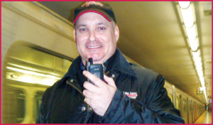 A-Way courier posing in subway with walkie-talkie. A-Way couriers deliver parcels and letters throughout Toronto using public transit.