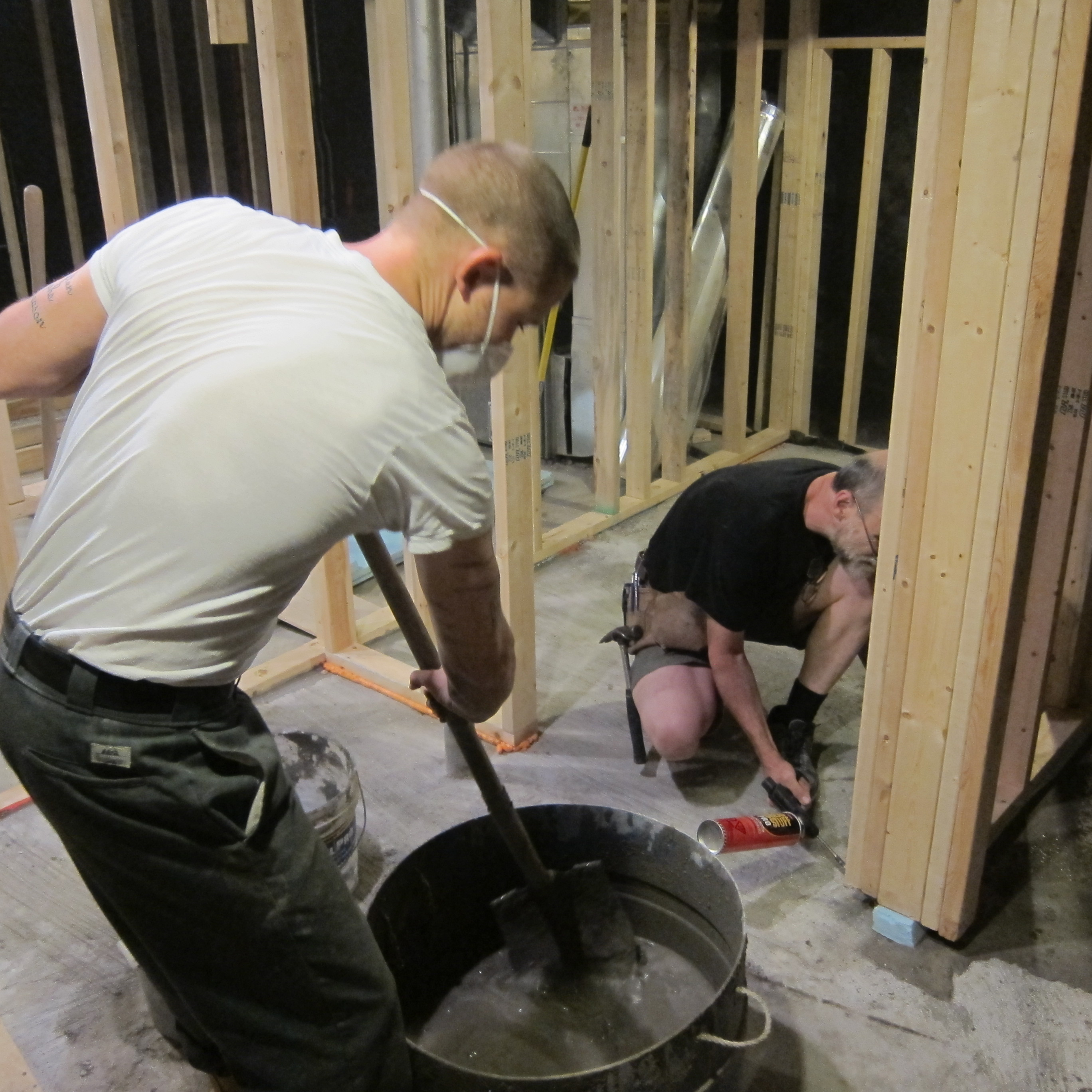 This is an image of two men doing interior construction of a new house.