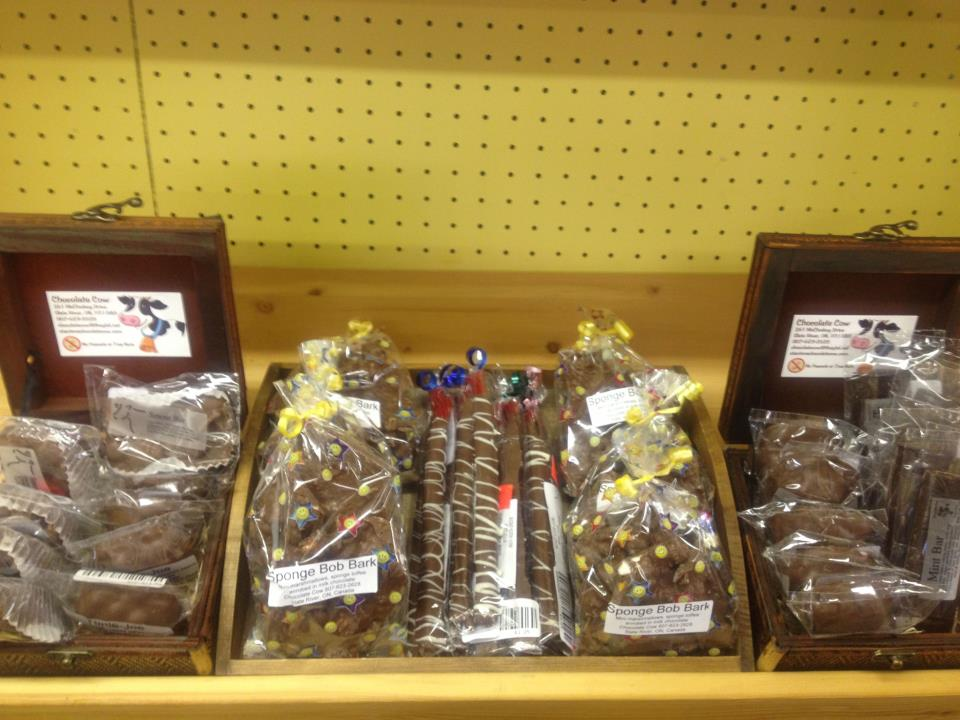 Shelf display of treats from The Chocolate Cow, a small nut-free artisan chocolate and desert shop.