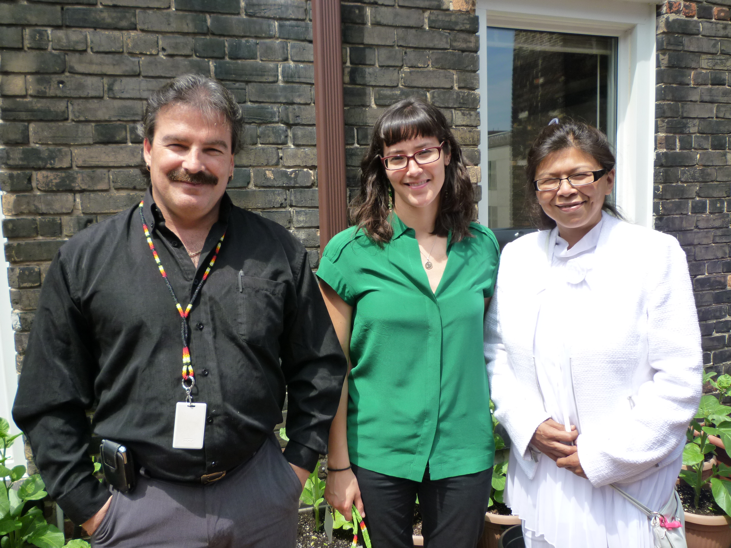 Chester Langille, in a black shirt, Candice Day in a green shirt and Georgina Franki, all in white.