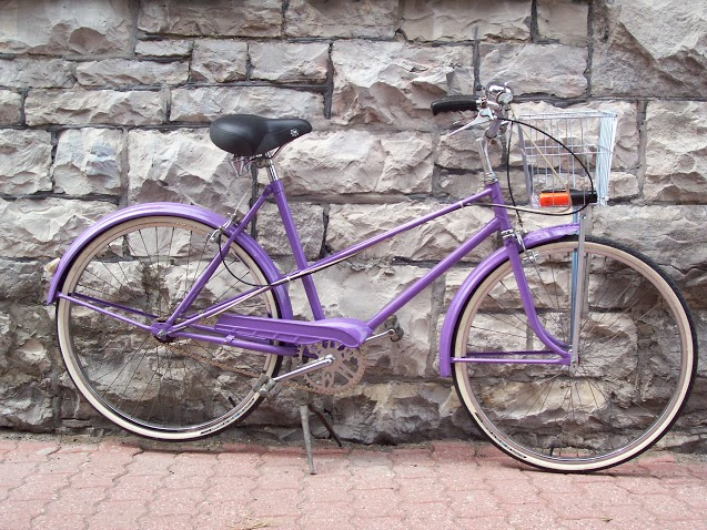A purple bicycle .