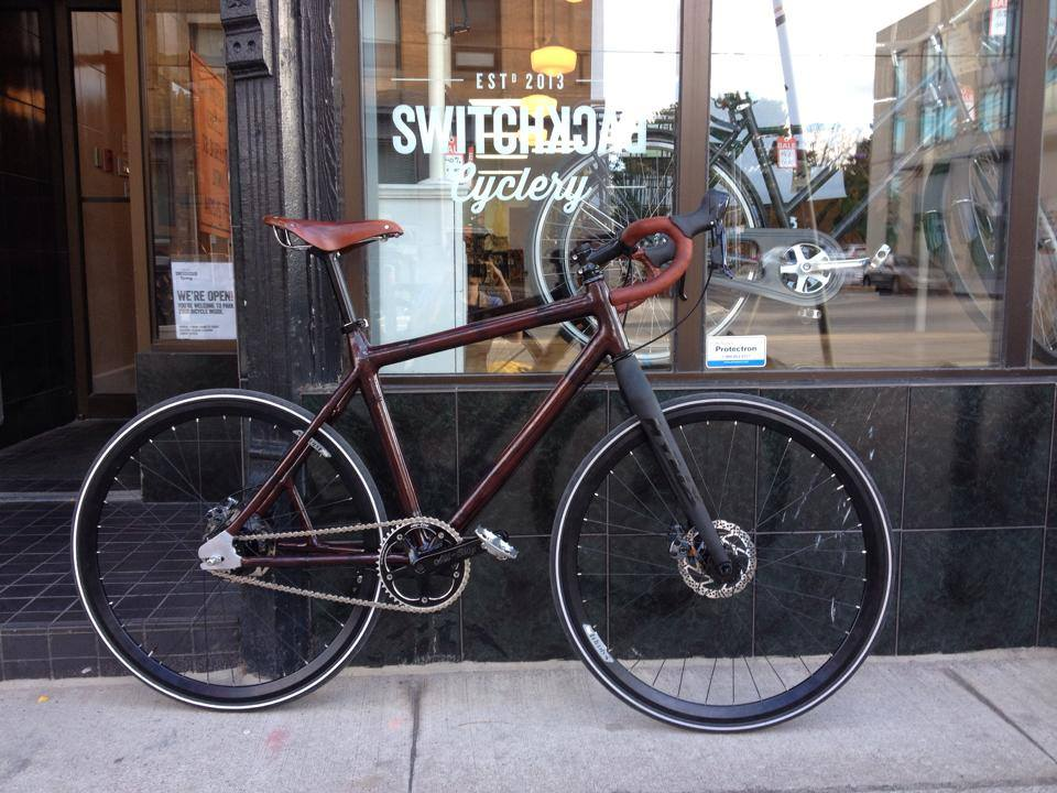 A custom built bike, by Switchback Cyclery, photographed in front of their store front.